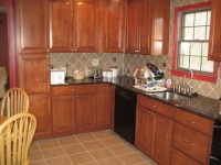 custom tile kitchen with granite counter top