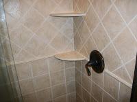 Ceramic tile shower with corner shelving